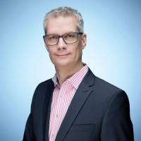 Porträtfoto von Dr. Uwe Kirschstein